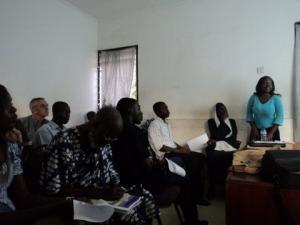 Joanne Nabbanja (standing) addressing the students