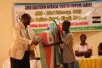 Handing over of flags from Louis-Coordinator of Rwanda Forum to Mark- Coordinator for next forum in Burundi