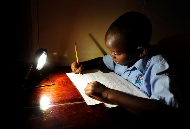 Christopher in Zambia does not have to fall back on his homework (Photo: Steve Woodward (SolarAid))