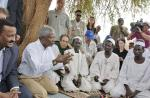 Kofi Annan (second from left), then UN Secretary-General, meets in 2004 with community leaders at the Zam Zam  Internally Displaced Persons Camp in the Darfur region of Sudan. Mohamed Sahnoun is at his left shoulder.